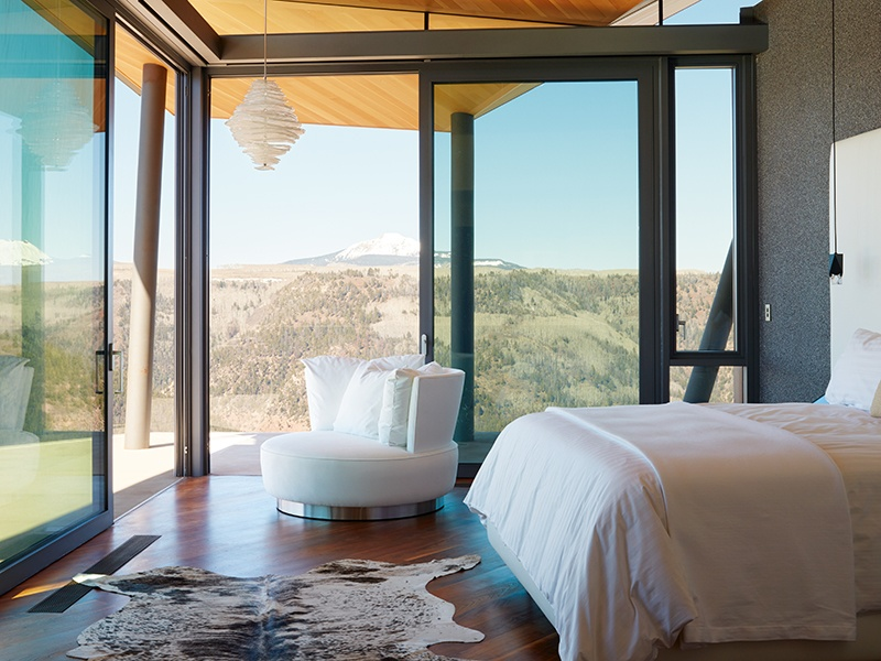 The master bedroom suite, with spectacular outdoor seating area, is supplemented on the upper floor with caretaker's quarters and a bunk room for eight.
