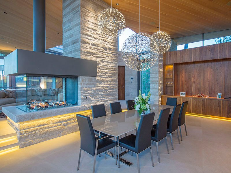 The design of the dining room at Sunset Ridge—offering views of the Telluride mountains and opening onto a spacious terrace—is perfectly in keeping with the property's bold, linear architecture.  Photograph: Telluride Real Estate