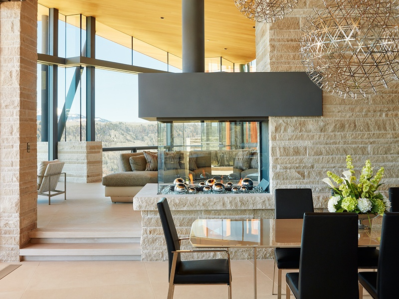 Open-plan living areas feature exquisite finishes that echo the natural splendor of the setting, such as limestone floors and walls, and marble and stone tiles.