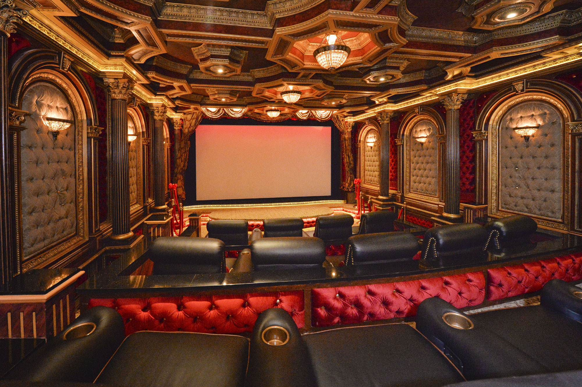 Framed by a beautiful Art-Deco inspired theater, this elegant home's commercial-grade screen and projection system is valued at around $80,000. Wall sconces, Corinthian columns, and a decorative ceiling create an Old Hollywood atmosphere.