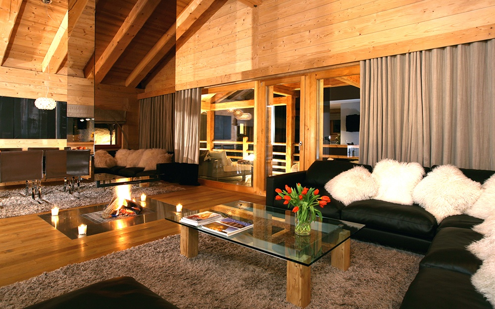 This ultra-luxurious chalet in the Alpine resort of Verbier has a glass fireplace in the master suite, a fireplace on the terrace, and a fire pit built into the floor of the great room.