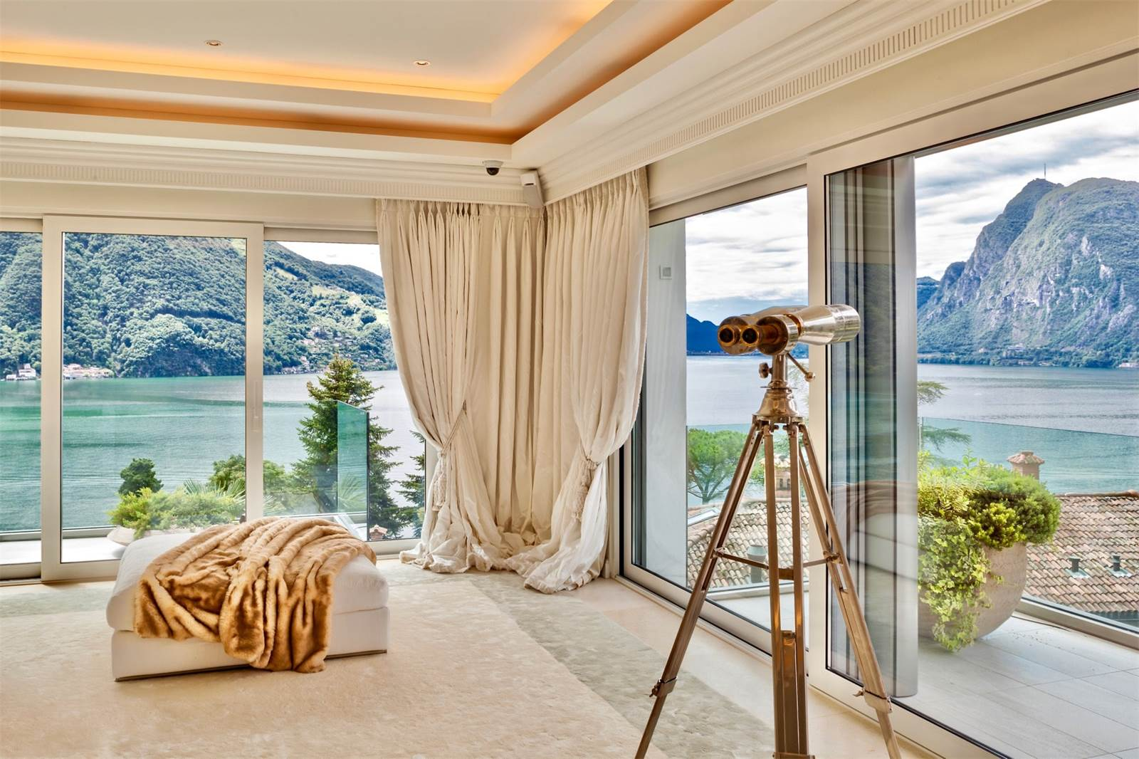 This luxury lair on the shores of Switzerland's Lake Lugano is as glamorous as they come. For an added layer of star appeal, a gold-plated telescope provides the finishing touch.
