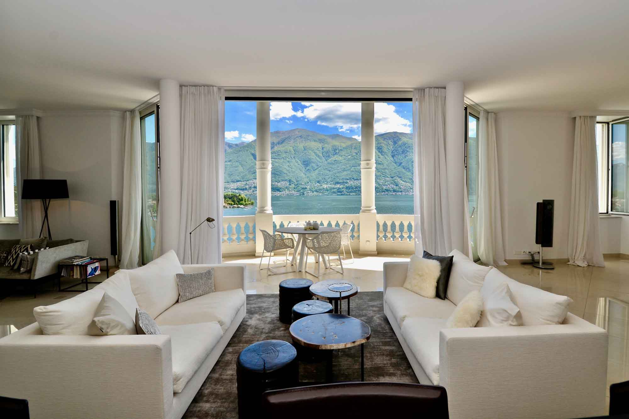 """Lake Maggiore's blue depths resonate through vistas offered by this unique """"sky chalet"""" penthouse in Ticino, Switzerland."""