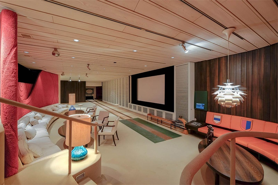 Villalta in the picturesque mountains of Castelrotto, Switzerland, is an alpine retreat with a surprise: inside the estate's sleek and modern interior, a full-size bowling alley awaits.