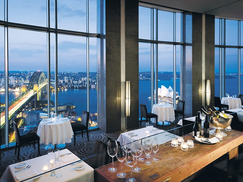 Floor-to-ceiling windows at the Shangri-La Hotel's Altitude Restaurant offer stunning views of Sydney Harbour. Banner image: Getty Images