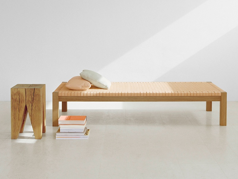 The THEBAN daybed is produced by e15, and constructed in waxed European oak with a woven leather surface. For added comfort, an unseen flexible textile layer is built into the sub-frame.
