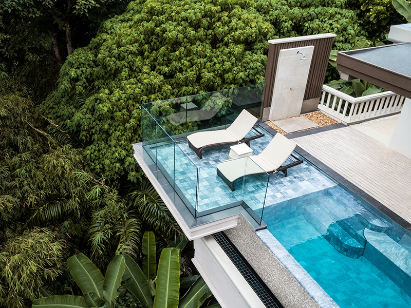 At Trisara, residences and villas sit on a terraced tropical hillside on the shores of the Andaman Sea. Accommodation ranges from suites (pictured) to villas, all in glorious garden settings with private pools and ocean views. Fine-dining restaurant Pru (banner image) overlooks the resort's private beach.