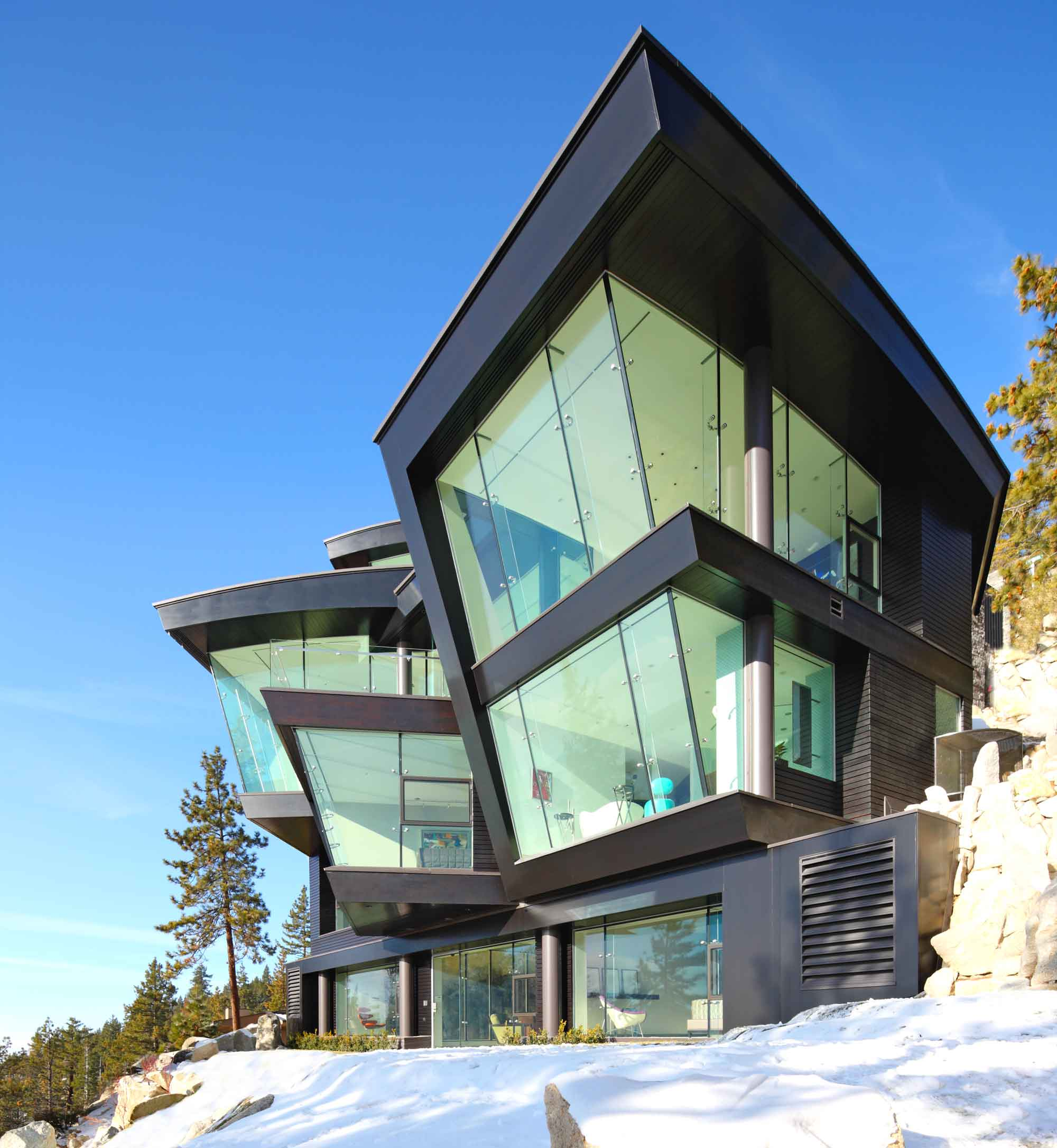 Lake Tahoe and the Sierra skyline from the dramatic backdrop to this ultra-modern lakefront estate, featuring angled walls of glass, a high-tech glass-enclosed elevator, and a six-story glass staircase.