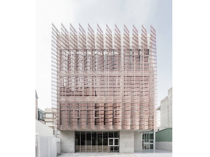 Tainan Tung-Men Holiness Church, built using concrete, warm wood, and copper accents—and feather-like metal screens on the exterior—is a project by China's MAYU architects+. Photograph: Shawn Liu Studio