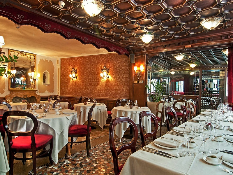 Visitors to Taverna La Fenice will enjoy its plush interior—dark red velvet, polished wood, and bright stucco—and its expansive terrace.