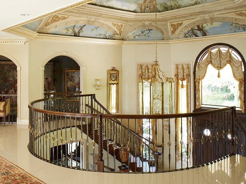 Gracing the soaring ceilings is a canopy of ornate murals and intricate moldings.