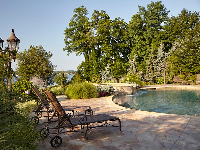 The salt-water pool, with elevated spa and cascading waterfalls, is surrounded by a Tennessee crab orchard stone patio.