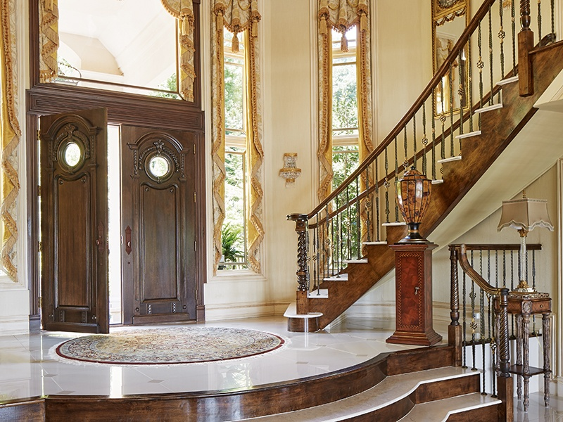 A sweeping, dual marble staircase, marble floors, and gilded coving give Terraces an air of European palatial living.