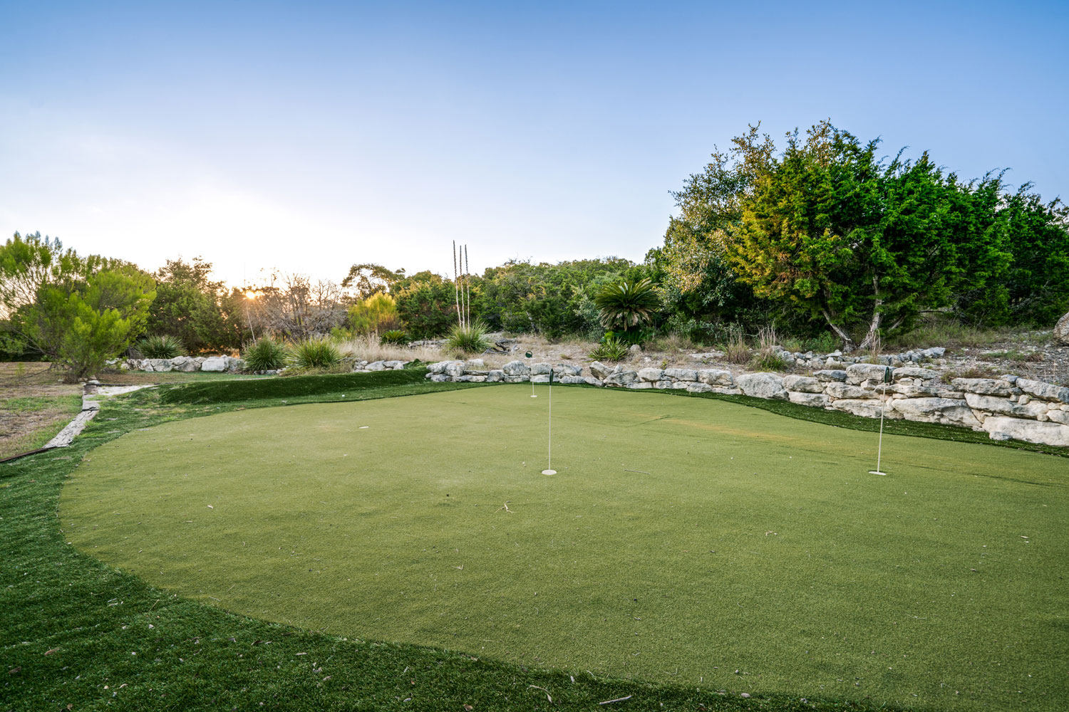 A putting green is one of the many surprises to be found on the estate's beautiful resort-style grounds.