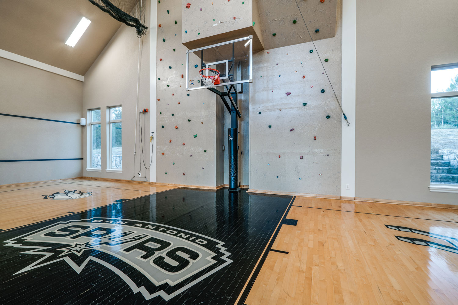 Designed for the serious sports enthusiast, this grand Mediterranean-inspired estate counts an indoor half-basketball court, an indoor rock-climbing wall, and a putting green among its outstanding facilities.