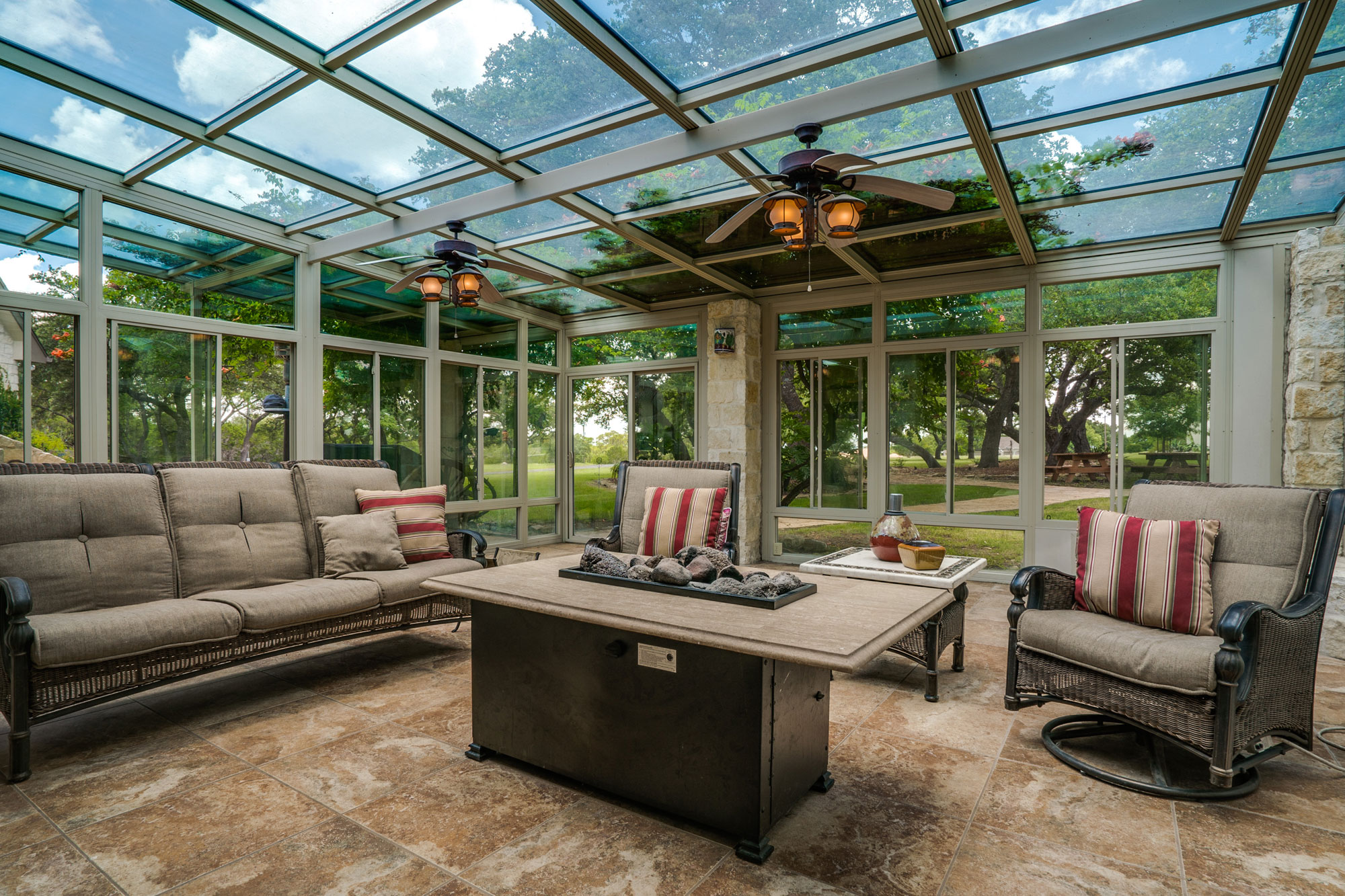 This 116-acre ranch estate outside San Antonio was designed to enjoy the beauty of Texas Hill Country; the glass-enclosed sunroom is a tranquil year-round escape with sliding glass doors to let in the summer breeze and a fire pit to warm the winter chill.