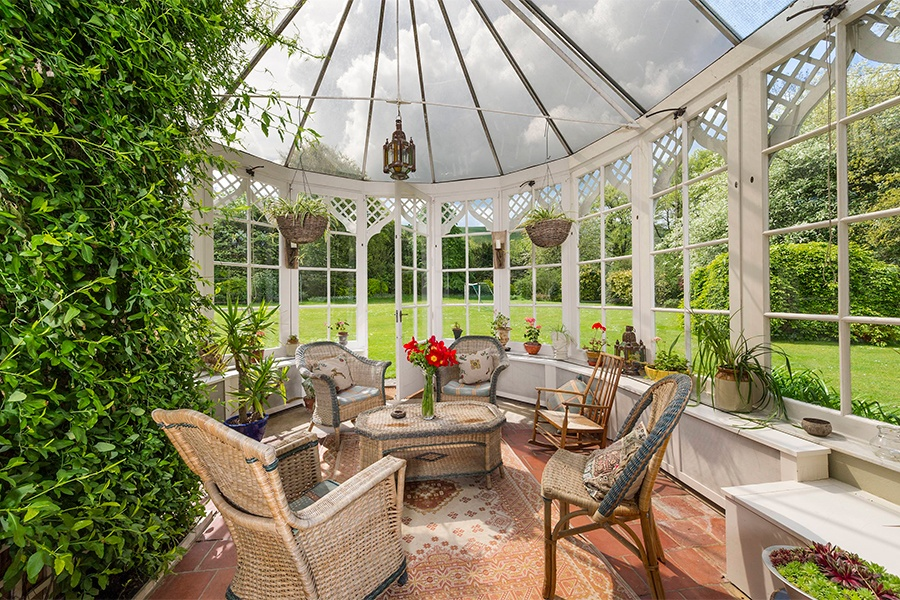 The Gothic-style orangery is a light-filled retreat that enjoys unrestricted views of the grounds from its wrap-around windows.