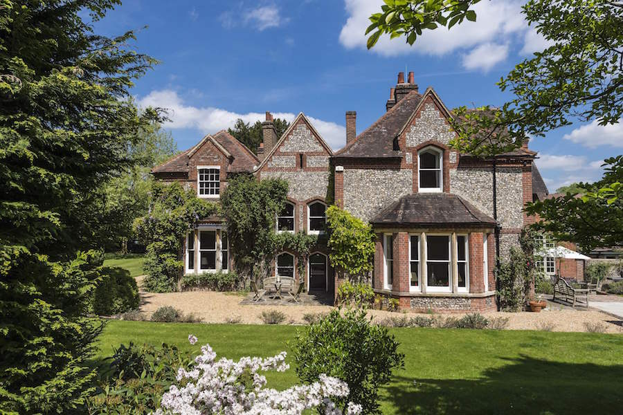 This brick-and-flint country house with mews cottage dates back to the early 18th century; renovations and modifications beginning in the 1740s have culminated in a home steeped in Victorian character.