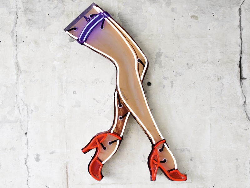 With their Pop Art sensibility, Sanders's works—among them dollar symbols, swimming-pool signage, crowns, a cheeky mermaid, and <i>Stilettos</i> (pictured)—nod to kitsch America. Photograph: Matt Rainwaters