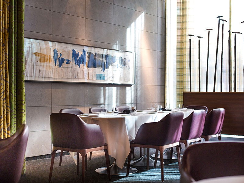 The deep burgundy color scheme, sumptuous chairs and banquettes, and long, sweeping curtains create a warm, luxurious space in which to enjoy Toqué! chef Normand Laprise's innovative cooking. Photograph: Bénédicte Brocard