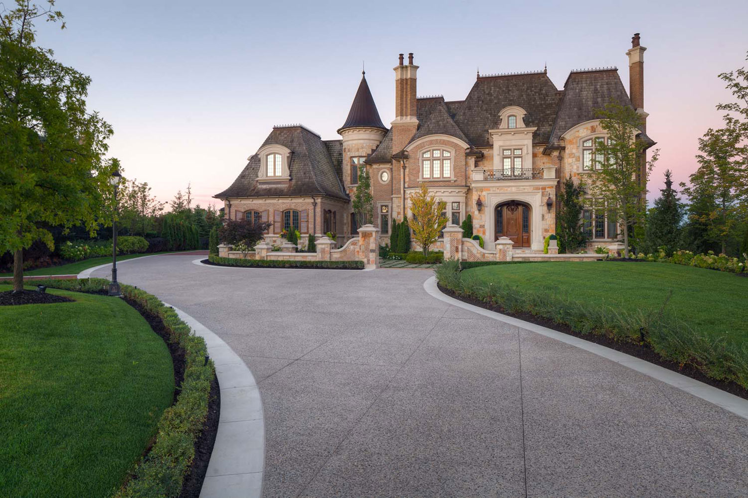 Outside Toronto, Canada, this French chateau-inspired residence in Kleinburg Village offers 1.28 acres of manicured grounds and the latest resort-style amenities.
