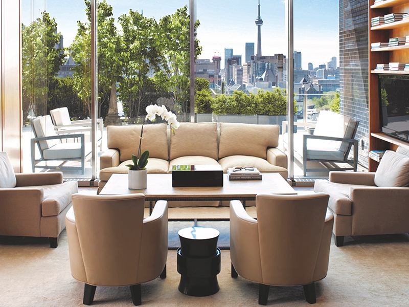 Designed by renowned architect Philip Johnson and renovated by JF Brennan, this landmark Yorkville apartment has breathtaking views of city attractions, including the iconic CN Tower.