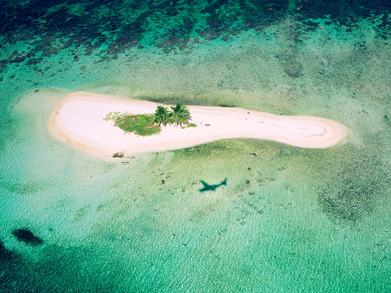 """For many, a private island means """"no shoes, no news""""; a total escape from the pressures of modern life. Photograph: 4Corners"""