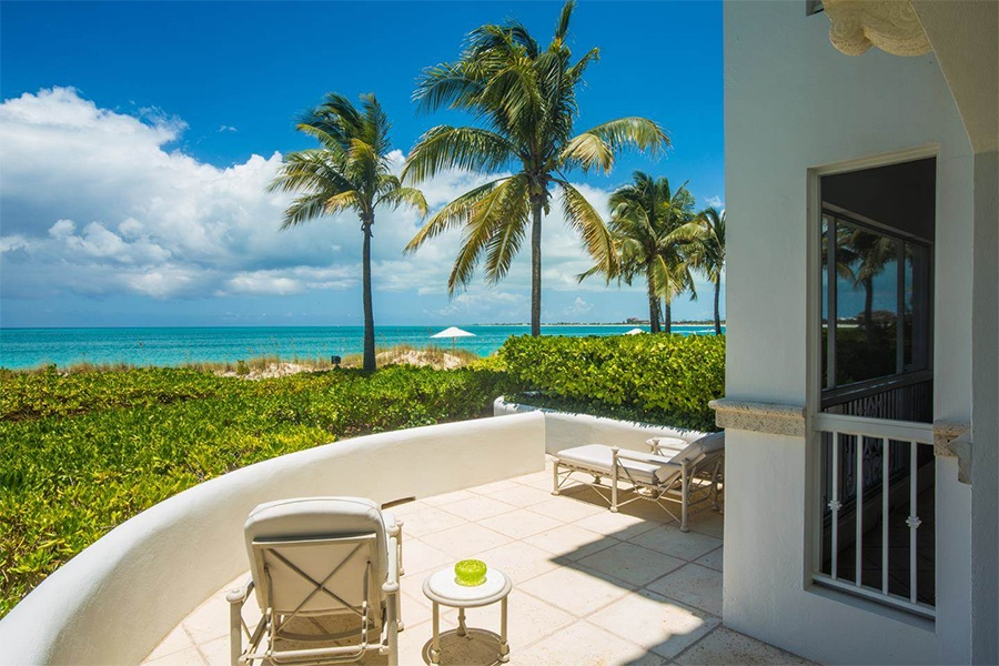 Gaze out across brilliantly hued tropical waters from the terrace of this villa in the Turks and Caicos Islands.