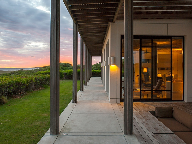 Los Primos is a double-faceted house; the east side has spectacular views of the sea and sunsets, while the west side looks out on to a pine forest and landscaped amphitheater.