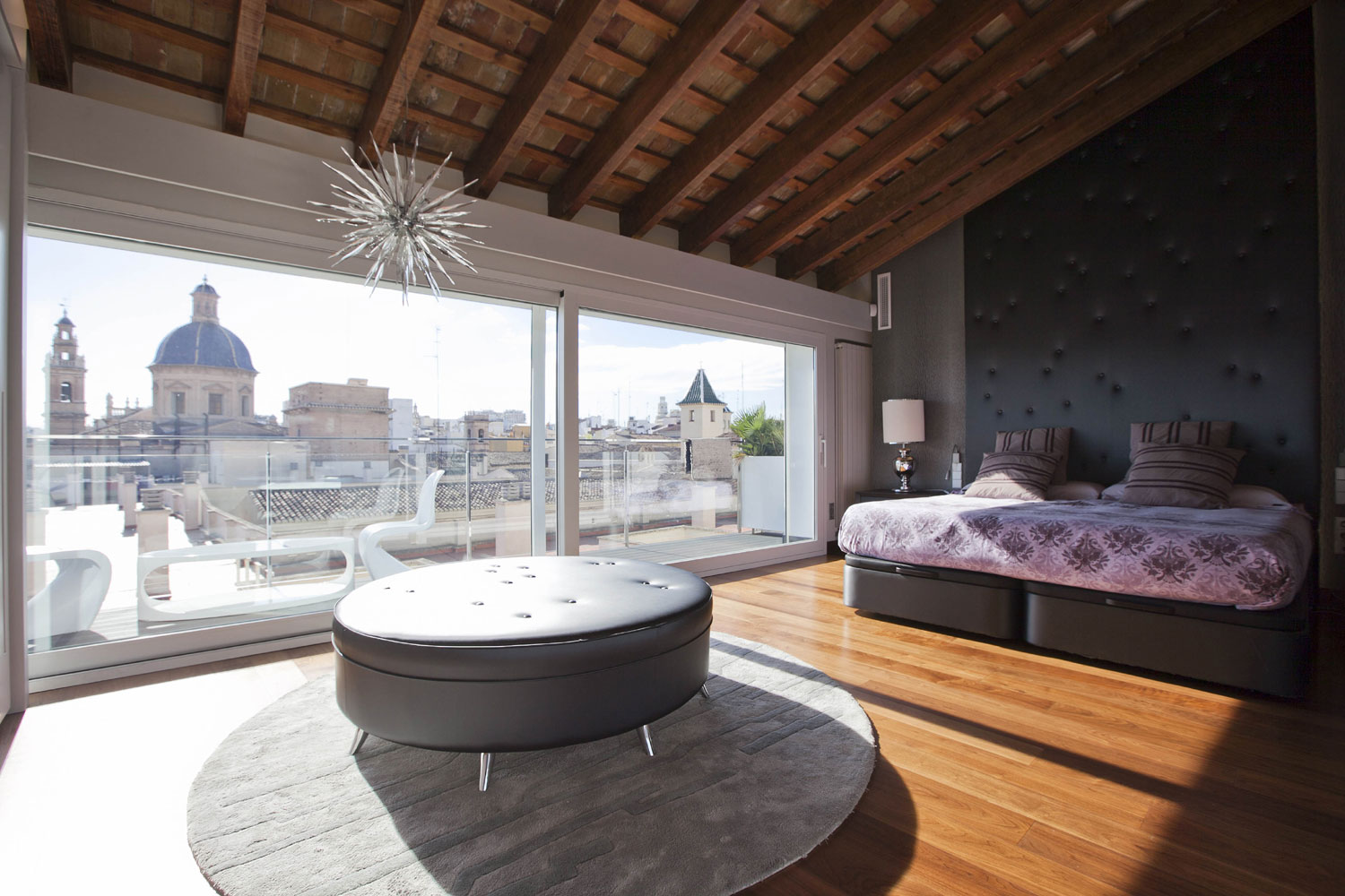 In Valencia, Spain, this designer penthouse offers luxury living spaces as well as spectacular views of the city's famous monuments.