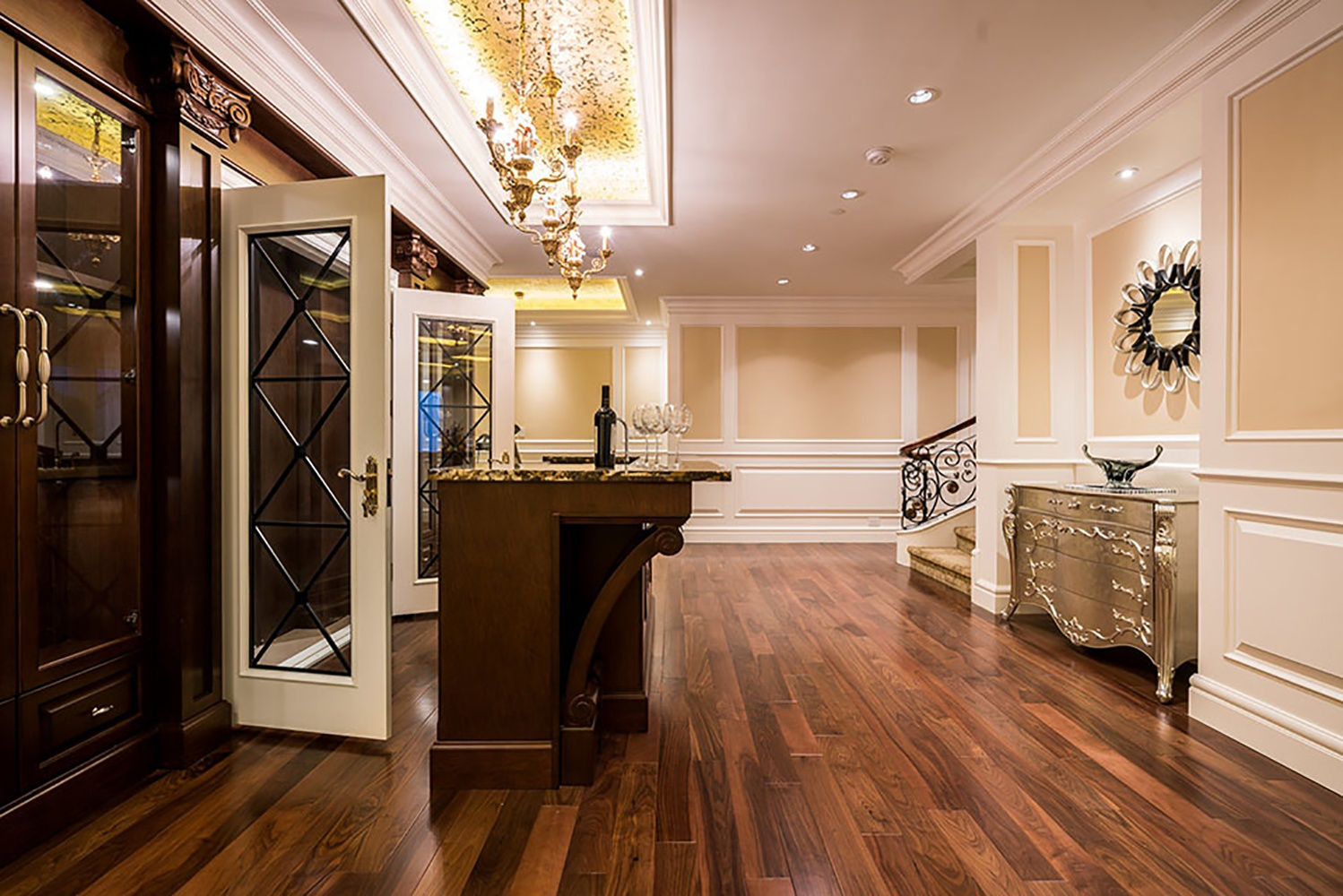 This home's lavish resort-inspired amenities include a lower-level entertainment center with a solid-wood wet bar and 300-bottle wine cellar.