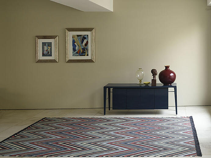 The rugs in Vanderhurd's From the Point collection include hand-woven flat-wave varieties with a zigzag design.