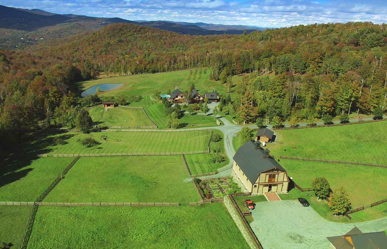 Birch Tree Farm is a classic New England farm with a stocked pond, apple orchard, and a bank barn with a few surprises: an equestrian facility and a luxury recreation and media center.