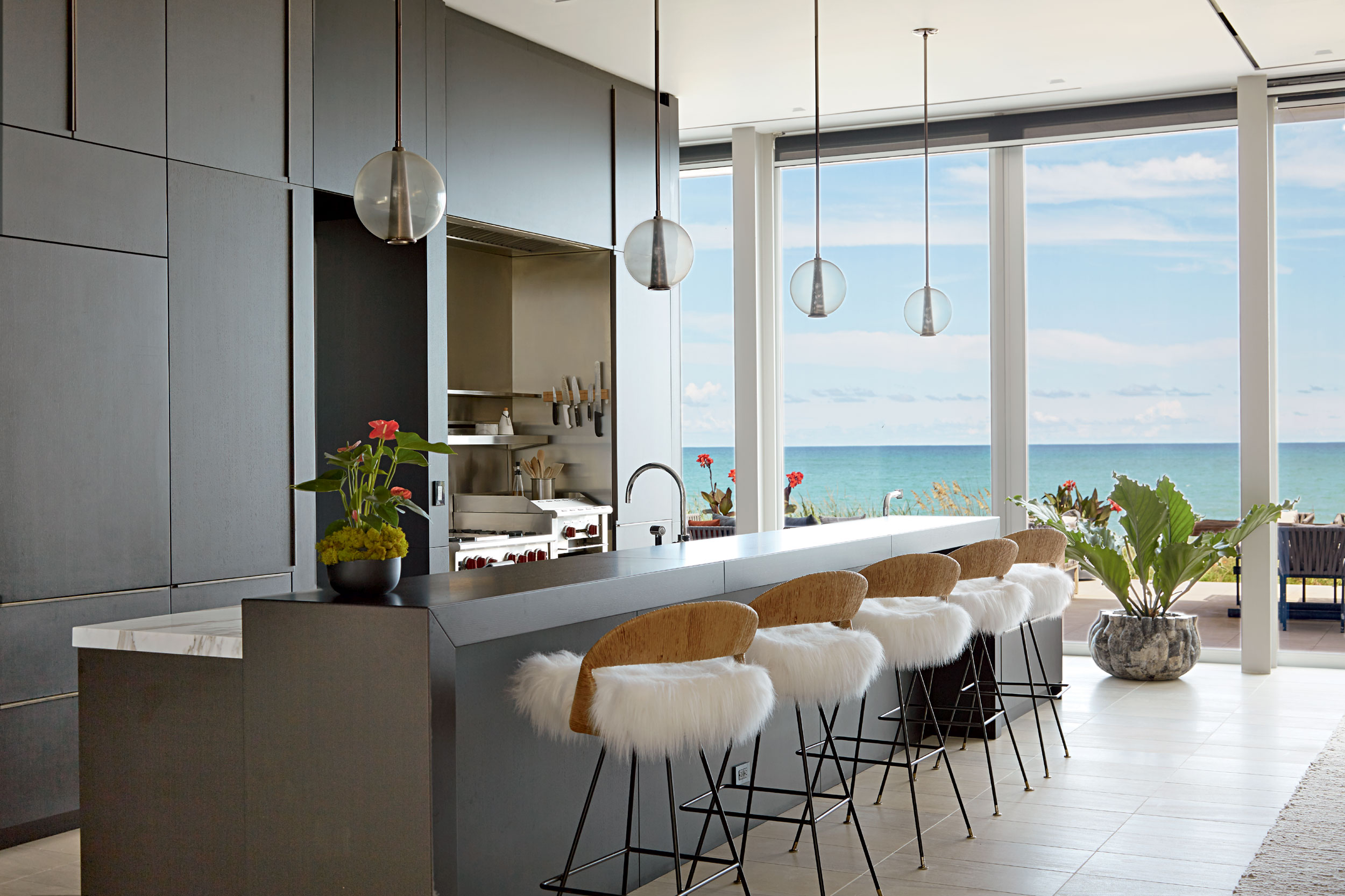 The spacious kitchen is a fully edged retreat in itself, with a breakfast island, relaxed dining area—as an alternative to the formal dining room—and free-flowing circulation to the outside space.