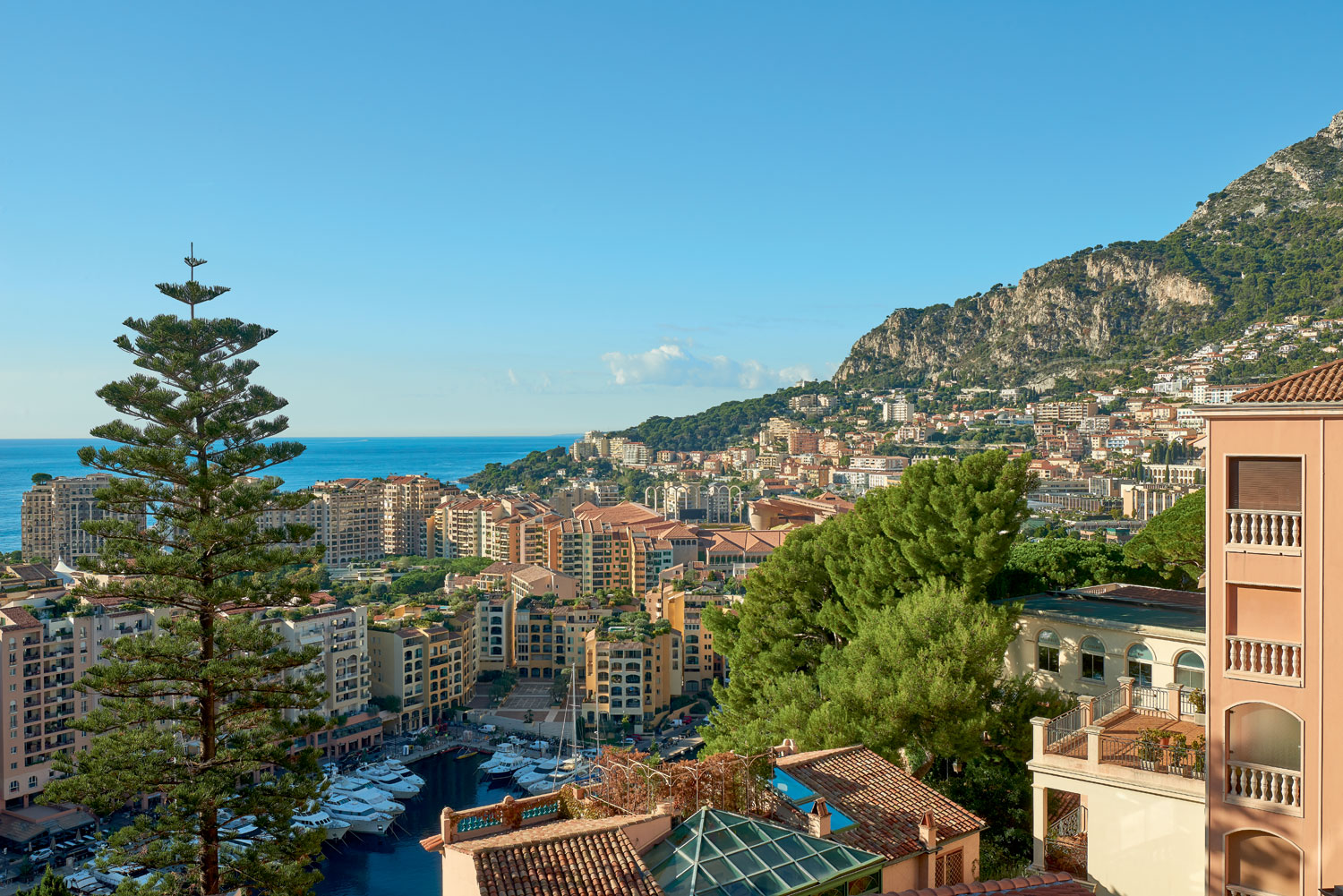 Monaco's azure waters combine with the warm, sunshine tones of the Old Town architecture to create rich panoramas—all of which can be enjoyed from Villa San Martin's wraparound balcony