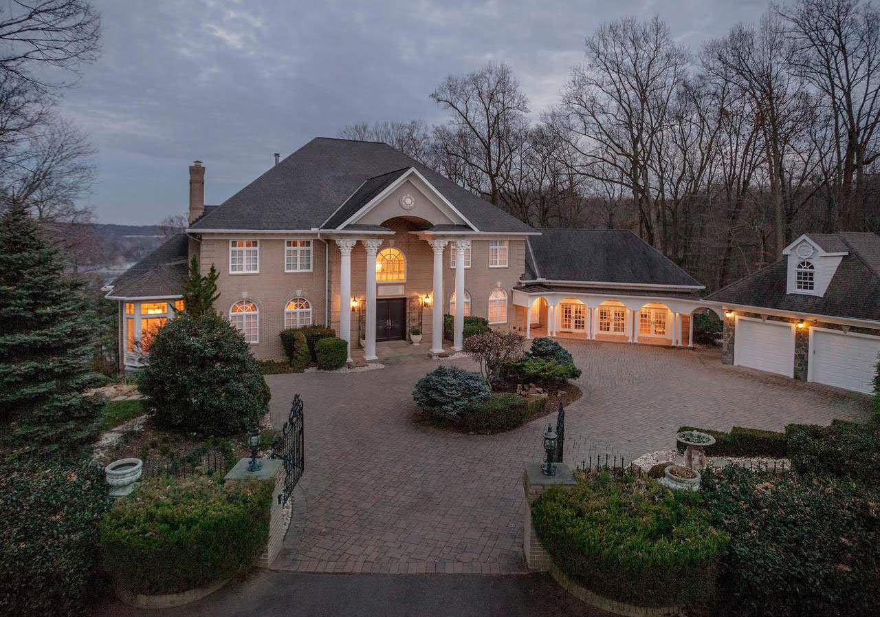 This stately colonial-inspired residence is defined by multi-tiered gardens with outdoor entertaining areas framed by the legendary Potomac River.