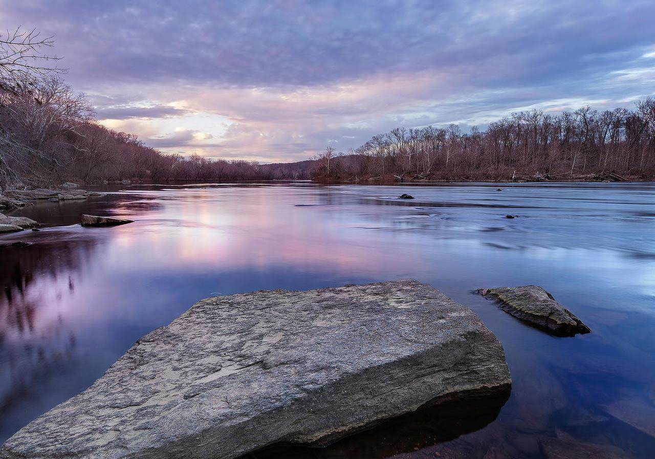 With 2.5 acres of grounds on the Potomac River, this estate offers water access for kayaking and fishing.