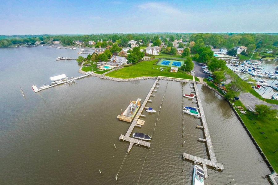 This classic Potomac property located approximately 20 miles outside downtown Washington, D.C., provides access to its community's private marina.