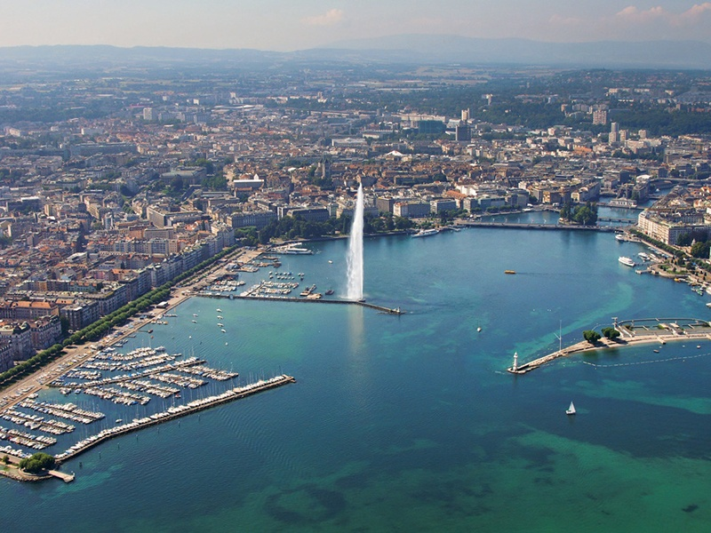 Lake Geneva is the centerpiece of the city, with a bustling harbor and the landmark Jet d'Eau water fountain. Photograph: Geneva Tourism