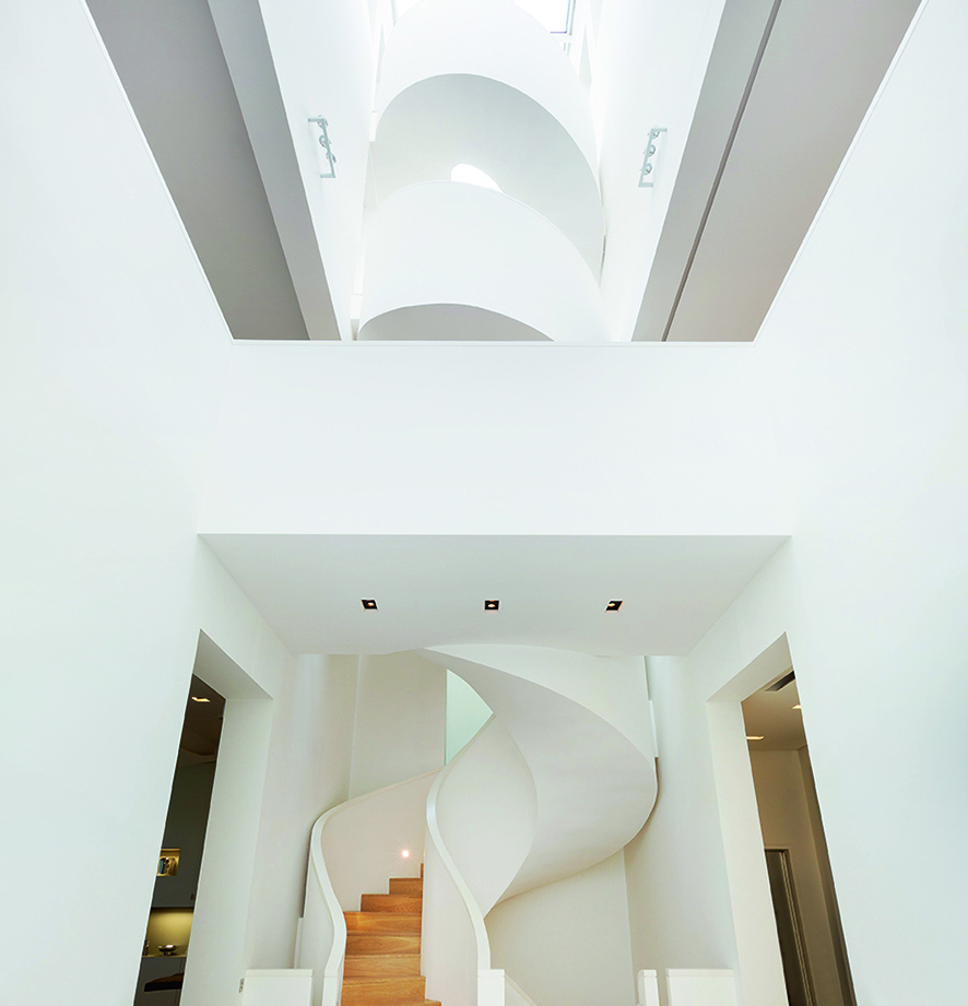 Taking center stage is the much-admired 100-foot staircase, twisting like a helix upwards to the other floors.