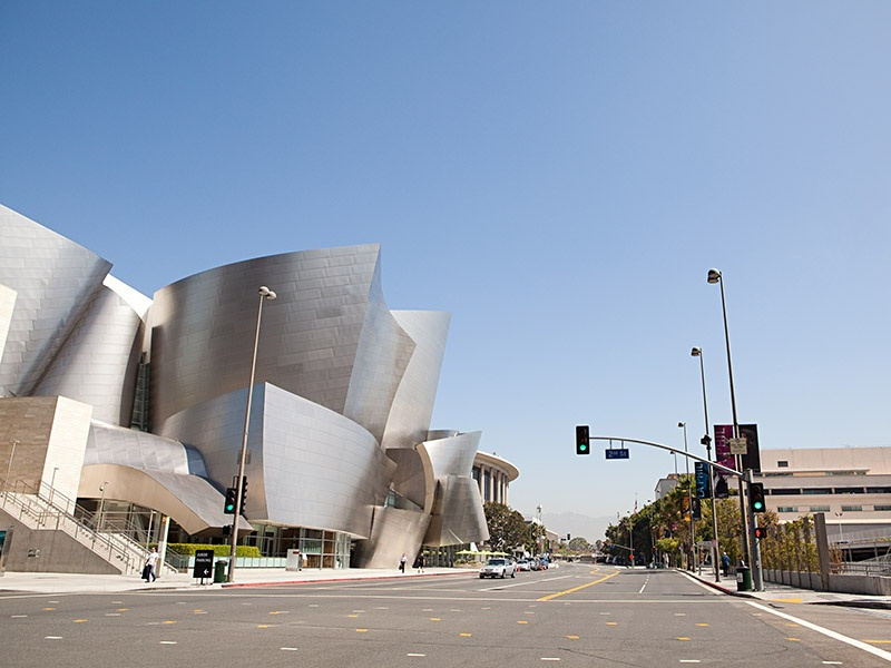The Walt Disney Concert Hall's distinctive exterior is made from sweeping stainless-steel panels designed by architect Frank Gehry to symbolize the movement of music, as well as the ebb and flow of life in Los Angeles.