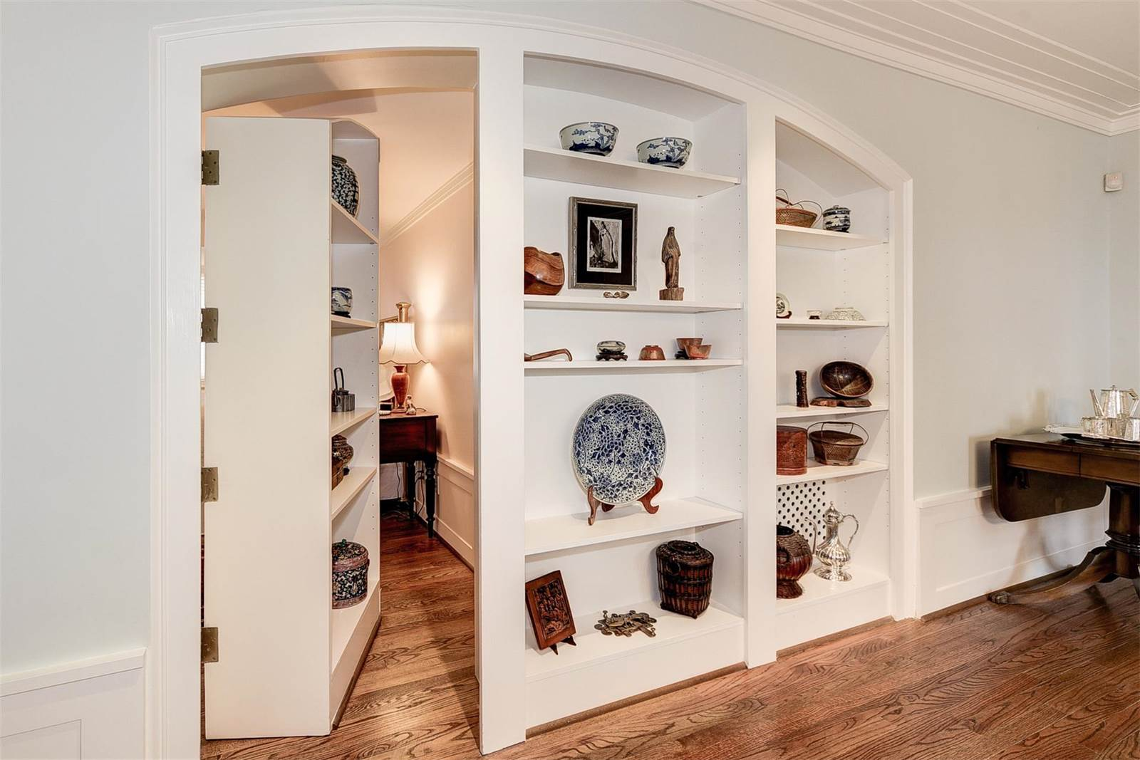 A private room hidden behind a display cabinet is just one of the alluring features of the historic Hornblower House in Washington, DC.