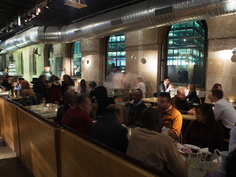 Set in Geneva's old market hall, Brasserie des Halles de l'Île is an industrial-style bar and restaurant serving French regional produce. Photograph: Geneva Tourism/Greg Martin