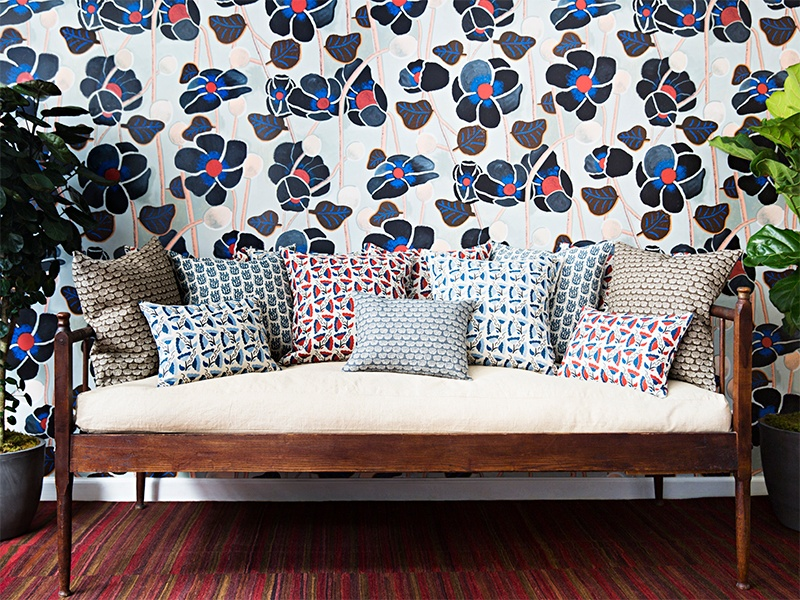 An assortment of Wayne Pate's designs, including Poppies Noir wallpaper and throw pillows in a variety of patterns. Photograph: Brittany Ambridge.
