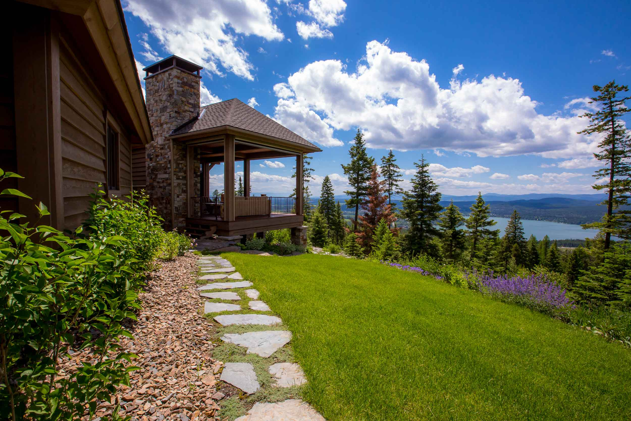 The rustic beauty of Montana's Flathead Valley wilderness is on full display from the multiple decks of this luxury log retreat.