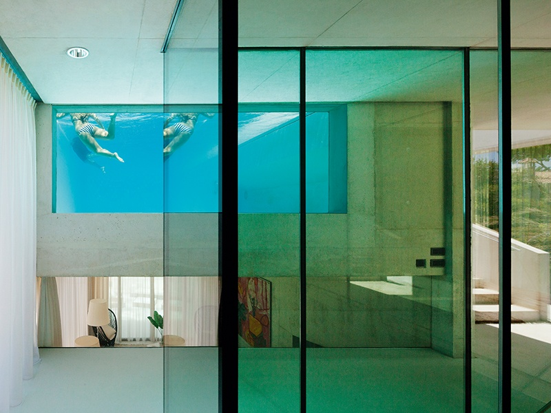 The pool at Jellyfish House in Spain is visible from nearly everywhere in the home. Photograph: Jan Bitter