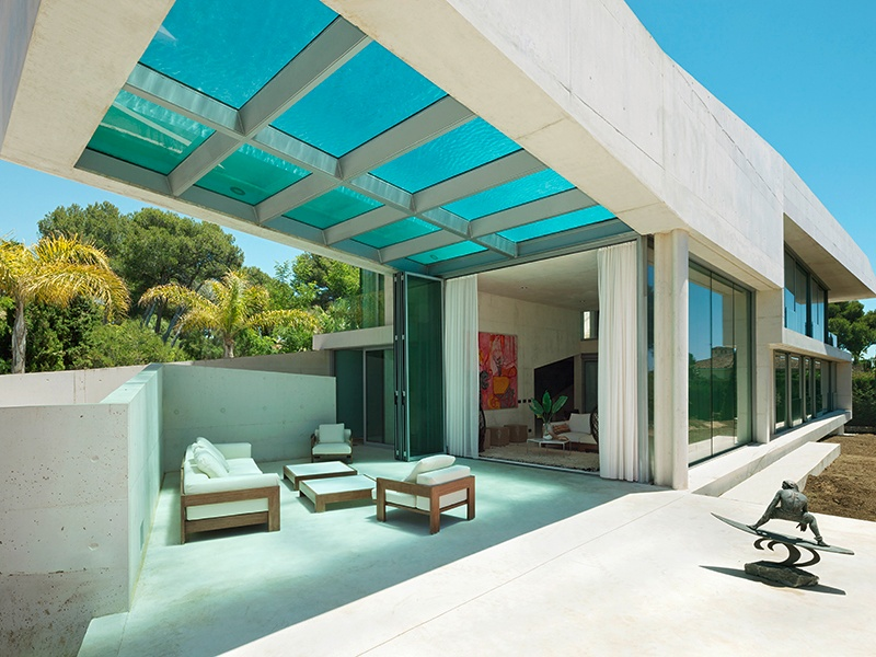 At Wiel Arets's Jellyfish House, located in Marbella, Spain, the pool is cantilevered from its roof, so that the beach and sea can always be seen while swimming. Photograph: Jan Bitter