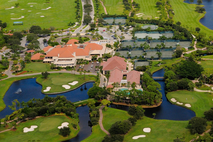This four-bedroom waterfront estate in a community with tennis facilities worthy of a champion, is located in Palm Beach Gardens, Florida, the town where the legendary Williams sisters make their home.