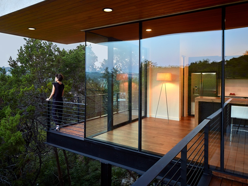 Occupying a site previously thought  too difficult to build on, Winn Wittman's Ravine House in Austin, Texas, makes use of tall columns to perch like a treehouse above the canyon. Banner image: The design of Ravine House maximizes views of the natural setting landscape.