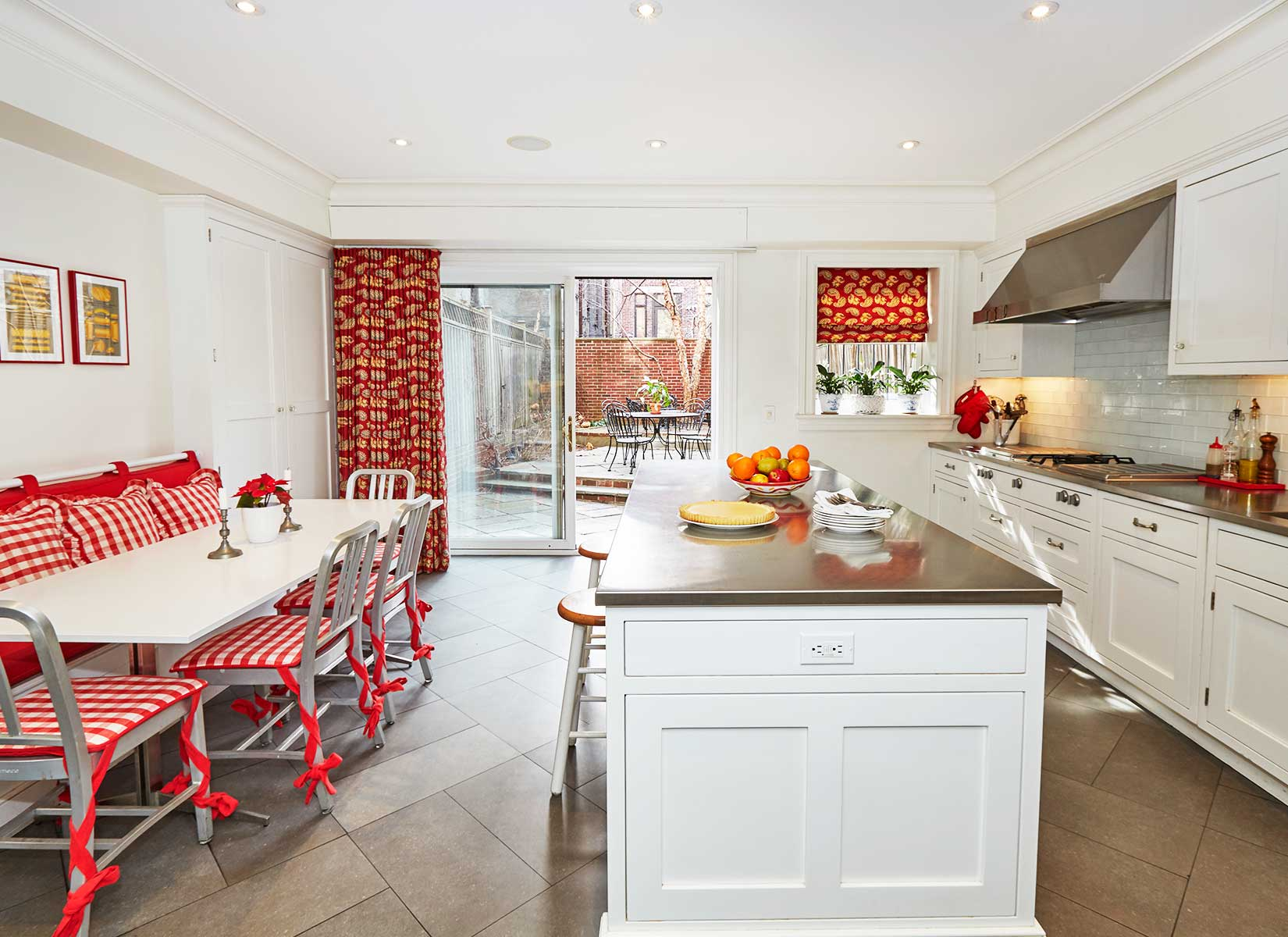 The eat-in kitchen is truly the heart of the home. The huge central island with stainless steel counter top offers impressive prep space with a lovely view of the beautiful south-facing garden and deck, ideal for alfresco dining and entertaining.